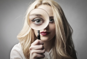 Woman magnifying glass